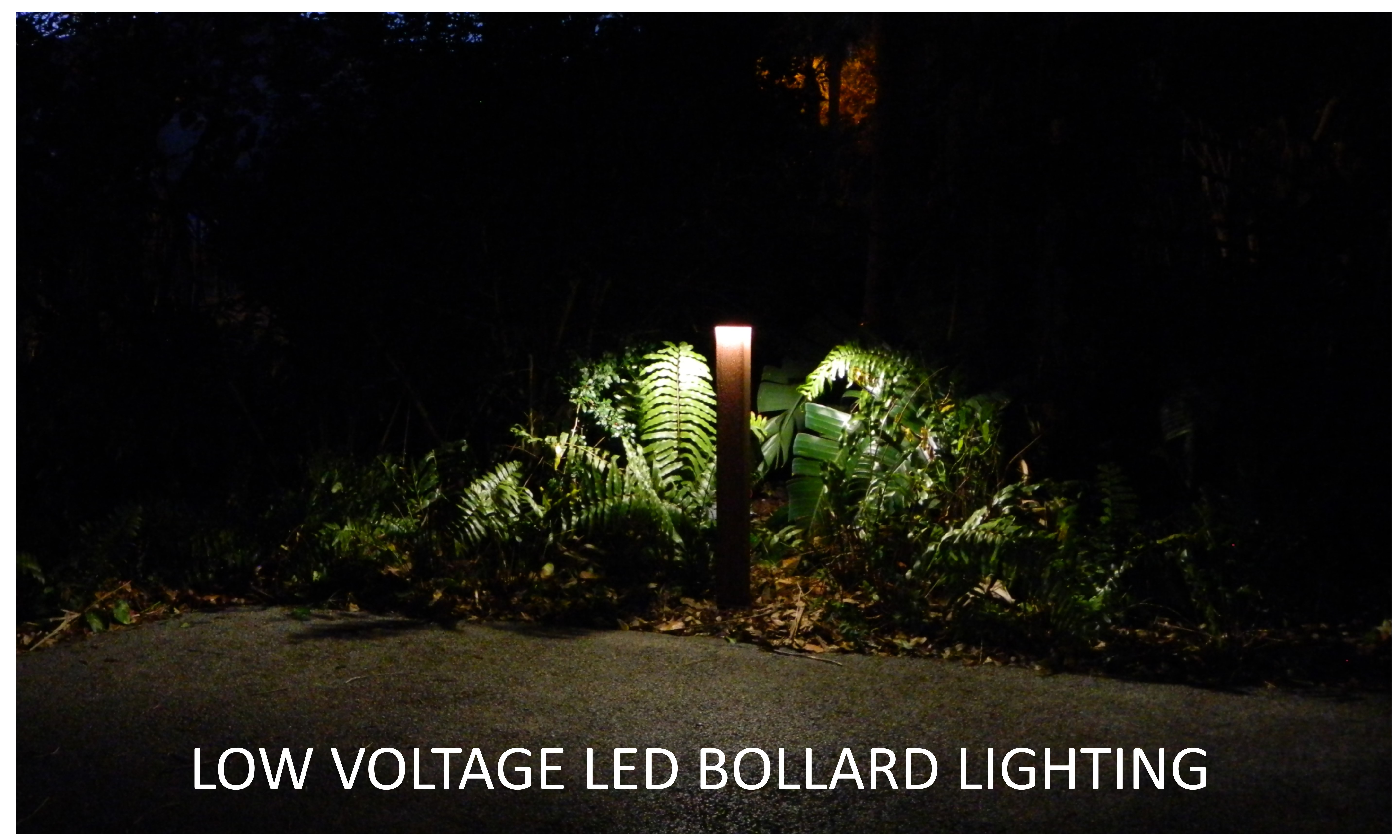 This is a photo of a low voltage LED bollard fixture in a landscaped area.