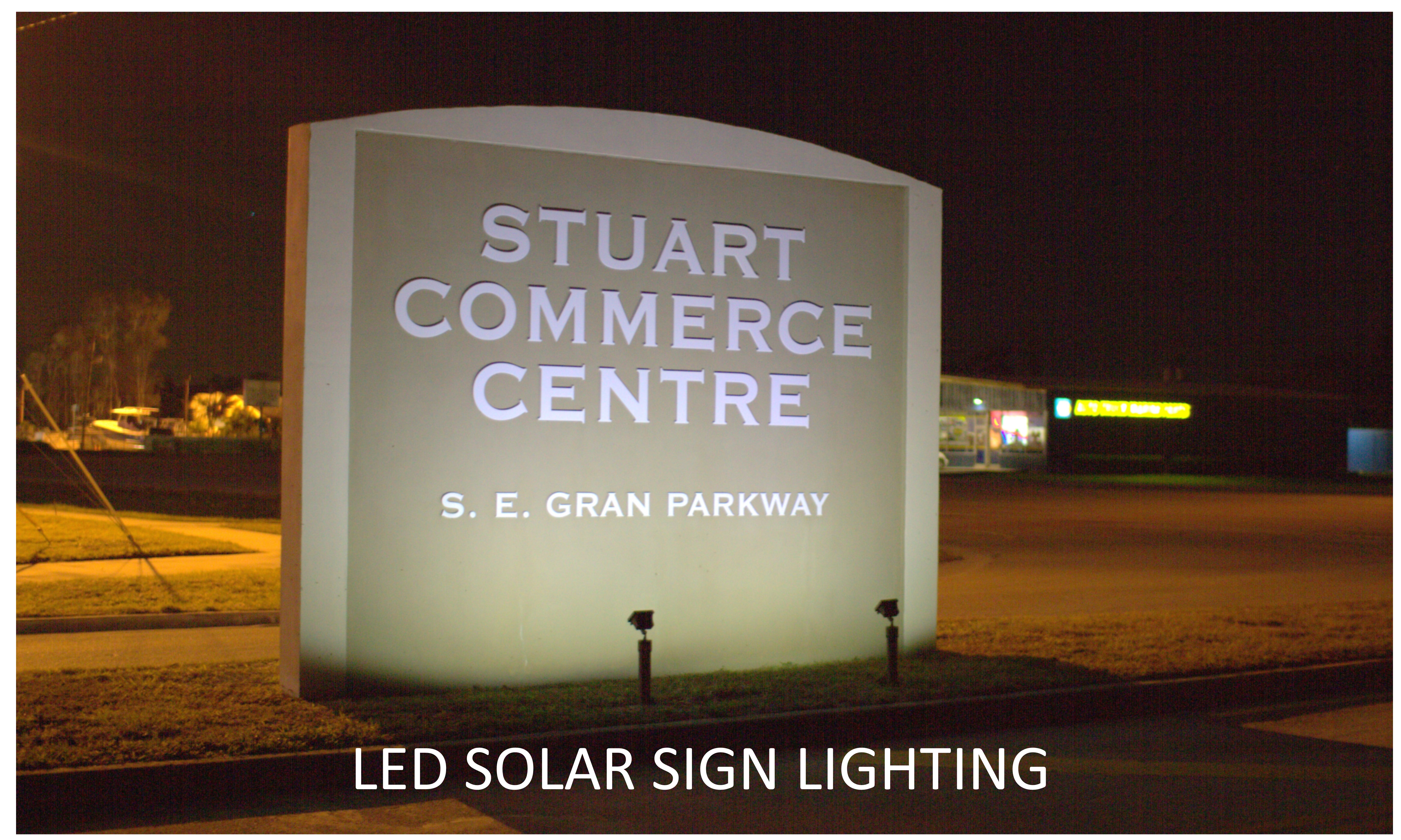 This is a photo of a sign lighted by a solar sign light.