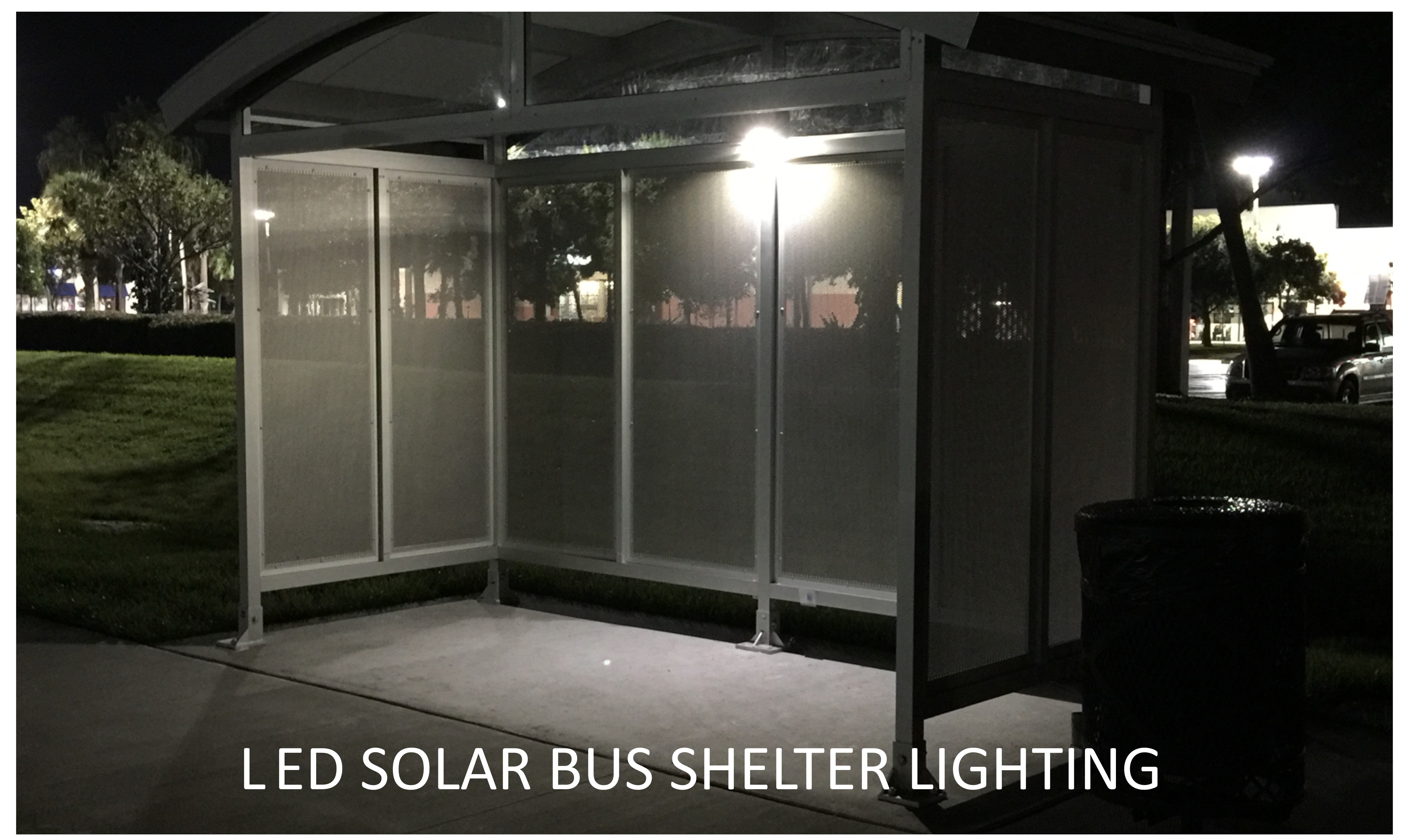 This is a photo of a bus shelter illuminated by a solar powered LED solar bus shelter light